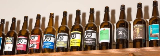 Labelled beer bottles on a shelf
